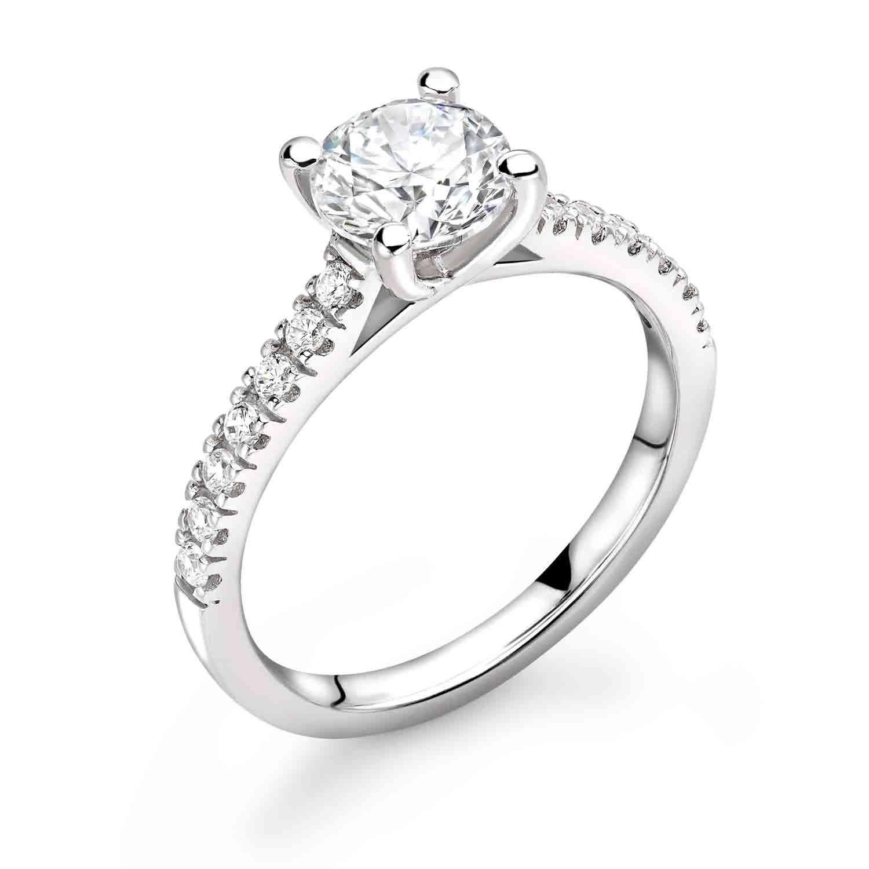Diamond ring with diamond set shoulders