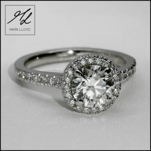 Classic diamond halo cluster ring, french pave set in platinum with diamond shoulders, 1 carat centre diamond with 0.50ct melee, £9,750