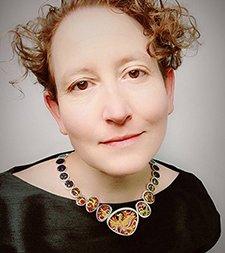 Sandra McEwen wearing her award winning necklace